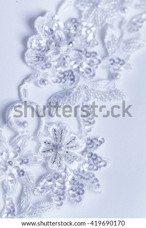 Luxury wedding lace with pearls - close up photo - stock photo