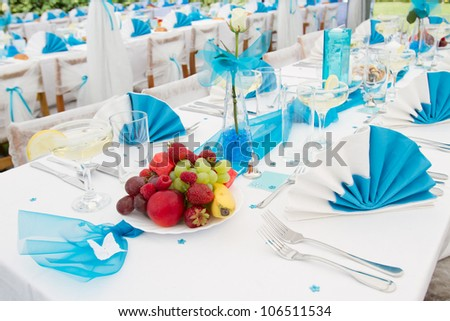 Luxury wedding lunch table setting outdoors, in white and blue colors - stock photo