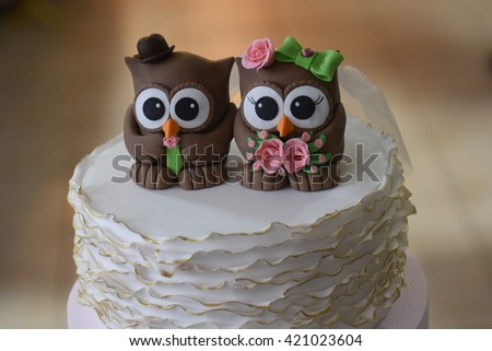 Luxury wedding white cake decorated with a funny owl figurines - stock photo