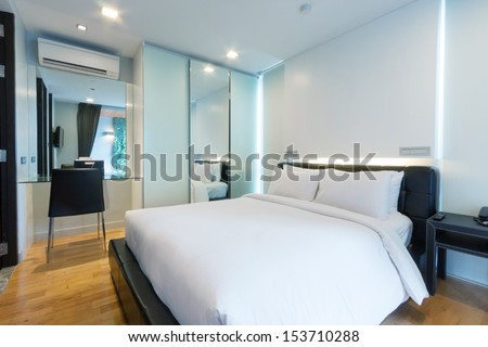 luxury white bedroom in apartment. - stock photo