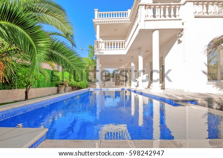 luxury white house with swimming pool luxury villa in classical style with columns backyard