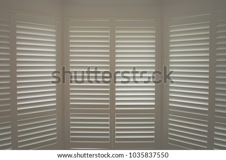 Luxury White Indoor Plantation Shutters Closed Stockfoto (Lizenzfrei ...