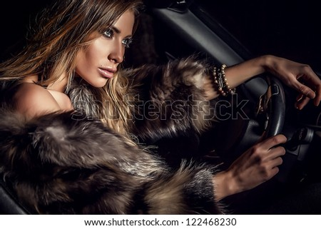 Luxury woman in a car. - stock photo