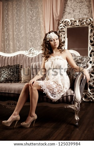 Luxury woman in fashion interior - stock photo