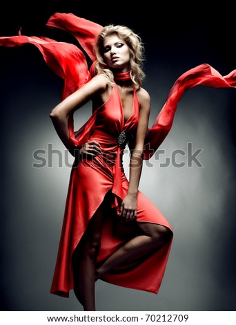 Luxury woman in red dress - stock photo