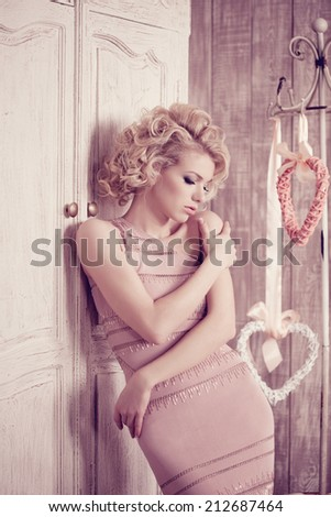 Luxury woman. Young fashionable slim pretty woman in the bedroom. Blonde in a luxurious interior. - stock photo