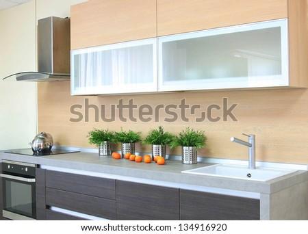 Luxury wooden brown modern kitchen - stock photo