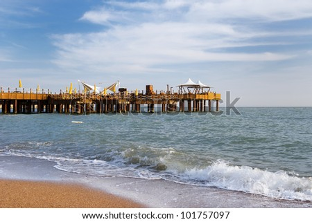 Luxury wooden pier with parasols in the sea