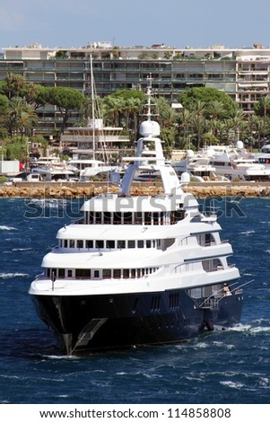 Luxury yacht anchored close to Cannes port, France. Forward view. - stock photo