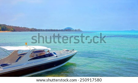 Luxury yacht is anchored by a little tropical Island    - stock photo