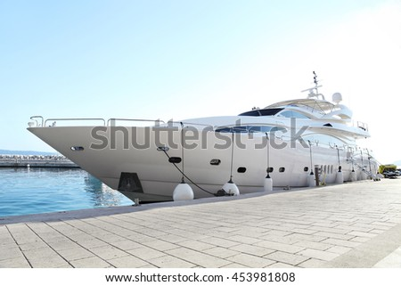 luxury yacht parked at dock - stock photo