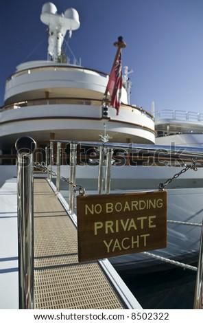 Luxury yacht with footbridge and christmas tree. - stock photo