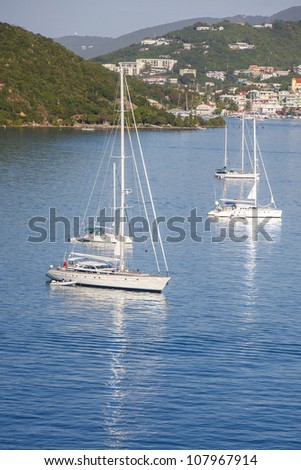 Luxury yachts and sailboats in a calm blue bay