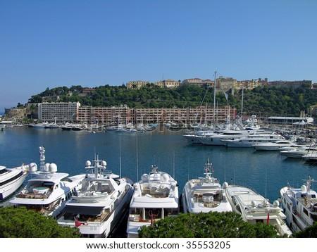 Luxury yachts in Monaco harbor - stock photo