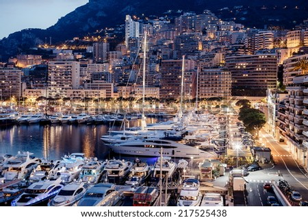 Luxury yachts in Monaco harbor at evening - stock photo