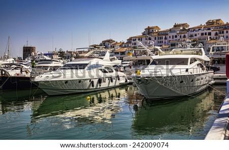 Luxury yachts in Puerto Banus, the marina of Marbella, Spain.  - stock photo