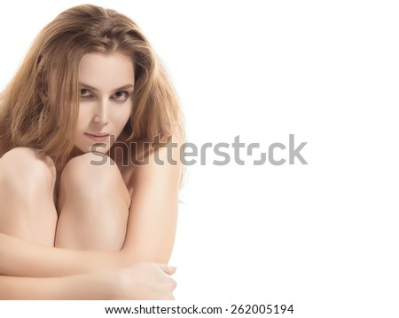 luxury young naked woman sitting on white background with copyspace - stock photo