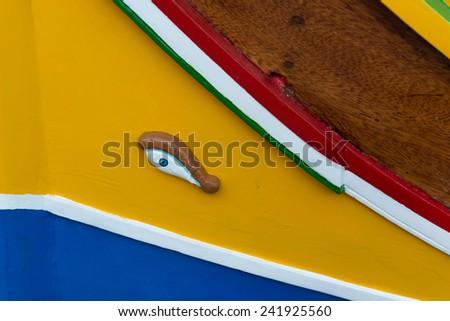 Luzzu, traditional eyed fishing boat in in Marsaxlokk village, Malta - stock photo