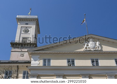 Lviv City Hall built in 1830-1845 tower 65 m height situated at Market or Rynok Square. It is a central square of city. Lviv - city in western Ukraine, capital of historical region Galicia. - stock photo