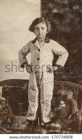 LVIV, FORMERLY POLAND, NOW UKRAINE, CIRCA THIRTIES - vintage photo of little girl in pajamas