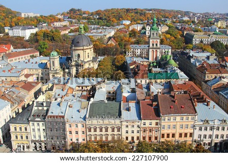Lviv old town view with Rynok square, Dominican church and Assumption Church, Ukraine - stock photo