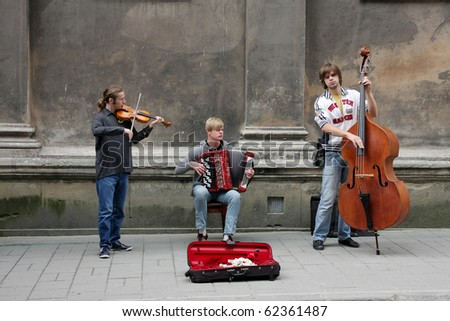 """LVIV - SEPTEMBER 26: Performance of street musicians, passing during IV of the Town holiday """"On coffee to Lviv"""" September 26, 2010 in Lviv, Ukraine - stock photo"""