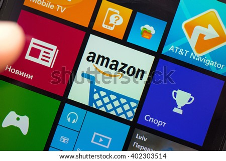 LVIV, UKRAINE - apr 06, 2016:  Closeup photo of Amazon icon on mobile phone screen. - stock photo