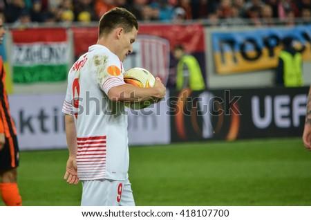LVIV, UKRAINE - APR 28: Kevin Gameiro beats penalty during the semi finals UEFA Europa League match between Shakhtar vs FC Sevilla (Spain), 28 April 2016, Arena Lviv, Ukraine - stock photo
