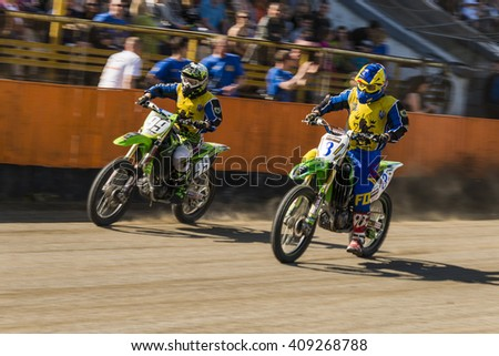 Lviv, Ukraine - 17 April 2016: Unknown riders overcomes the track at the  Flat Track  National Championship series to the Lviv city - stock photo