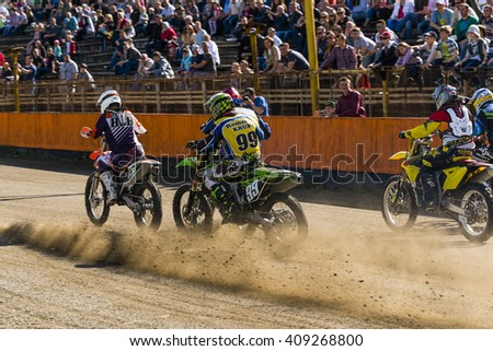 Lviv, Ukraine - 17 April 2016: Unknown riders  starts  at the  Flat Track  National Championship  to the Lviv city - stock photo