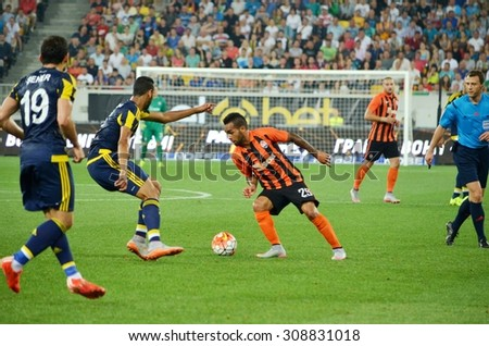 LVIV, UKRAINE - AUG 5: Teixeira (C) in action during the UEFA Champions League match between Shakhtar vs Fenerbahce, 5 August 2015, Arena Lviv, Lviv, Ukraine
