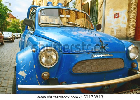 LVIV, UKRAINE - AUG 15: Vintage restored and tuned blue ZAZ-965 Zaporozhets car (released circa 1960 in USSR) parked at Hrushevskiy street on August 15, 2013 in Lviv, Ukraine.