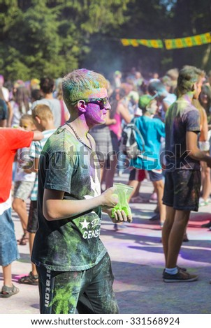 Lviv, Ukraine - August 30, 2015: Man with glases have fun during the festival of color in a city park in Lviv.