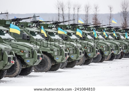 LVIV, UKRAINE - DECEMBER 30, 2014: Armed forces of Ukraine.  Military and armored vehicles at the International Center for Peacemaking and safety before transferring it into zone of military conflict - stock photo