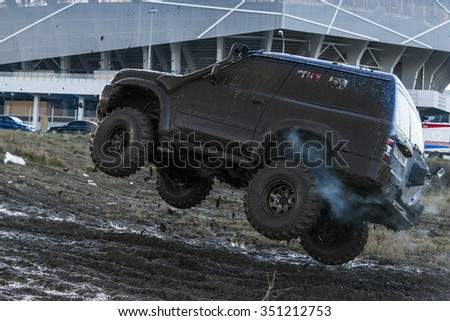 Lviv,Ukraine- December 6, 2015: Off-road vehicle brand Nissan overcomes the track on a polygon near the city Lviv, Ukraine
