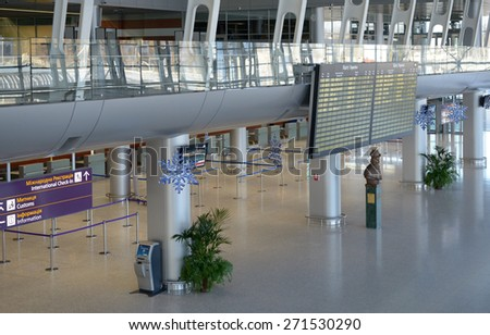 LVIV, UKRAINE - DECEMBER 31, 2012: Timetable in the Danylo Halytskyi International airport. The new terminal built for Euro-2012 can service up to 2000 passengers per hour - stock photo