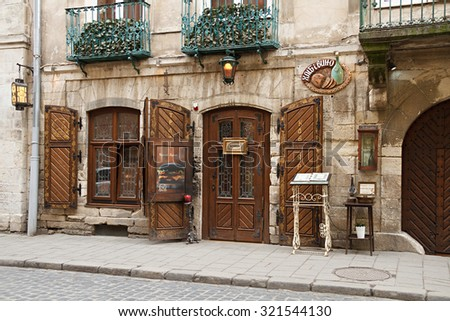"Lviv, Ukraine, Europe - March 06, 2015: Picturesque nook, street cafe ""Bread and wine"" in old town Lviv."