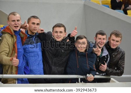 LVIV, UKRAINE - FEB 18: Fans at the stadium support their team during the UEFA Europa League match between Shakhtar vs Schalke 04 (Germany), 18 February 2016, Arena Lviv, Ukraine