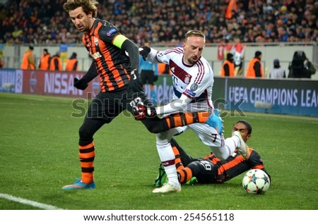 LVIV, UKRAINE - FEB 17: Franck Ribery (R) in action against Dario Srna (L) in the Champions League match between Shakhtar vs Bayern Munich, 17 February 2015, Arena Lviv, Lviv, Ukraine