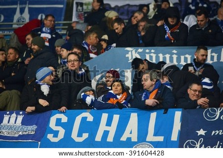 LVIV, UKRAINE - FEB 18: German fans Schalke 04 support their team at the stadium during the UEFA Europa League match between Shakhtar vs Schalke 04 (Germany), 18 February 2016, Arena Lviv, Ukraine