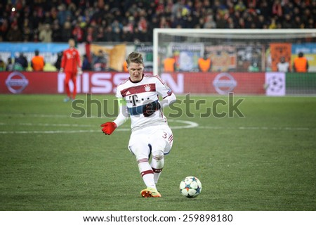 LVIV, UKRAINE - FEBRUARY 17, 2015: Bastian Schweinsteiger of Bayern Munich controls a ball during UEFA Champions League game against FC Shakhtar Donetsk at Arena Lviv stadium - stock photo