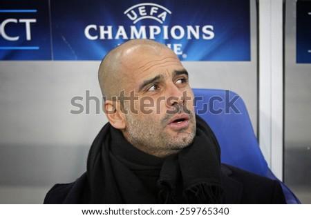LVIV, UKRAINE - FEBRUARY 17, 2015: FC Bayern Munich manager Josep Guardiola looks on during UEFA Champions League game against Shakhtar Donetsk at Arena Lviv stadium - stock photo