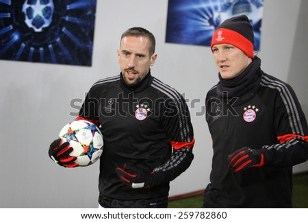 LVIV, UKRAINE - FEBRUARY 17, 2015: Franck Ribery talks with Bastian Schweinsteiger of Bayern Munich before UEFA Champions League game against FC Shakhtar Donetsk - stock photo