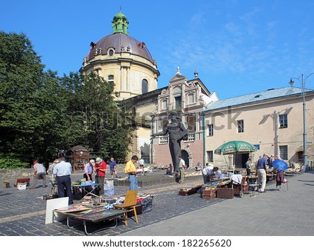 LVIV, UKRAINE - JULY 10, 2010: Book flea market near the monument of Ivan Fyodorov, the first printer in Russia and Ukraine. The monument was unveiled on November 26, 1977.