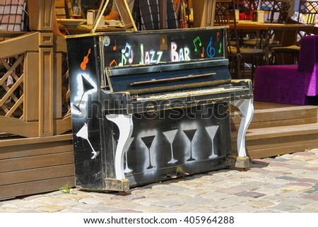 Lviv, Ukraine - July 5, 2014: Old piano near outdoor terrace of restaurant Persha Klyasa in historic city center (Rynok Square)