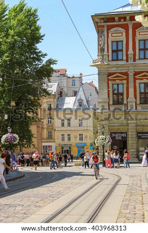 Lviv, Ukraine - July 5, 2014: People on street in the Old Town (Rynok Square). Lviv historic city center is on the UNESCO World Heritage List