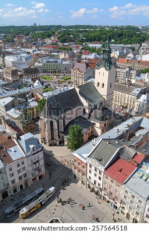 LVIV, UKRAINE - JULY 10, 2010: View of Latin Cathedral and corner of Rynok Square from City Hall. The Cathedral was founded in 1360 by the king Casimir III of Poland and finally consecrated in 1481. - stock photo