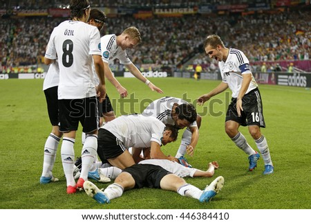 LVIV, UKRAINE - JUNE 17, 2012: Players of Germany national football team celebrate their winning after the UEFA EURO 2012 game against Denmark at Lviv Arena in Lviv, Ukraine