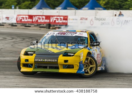 Lviv, Ukraine - June 4, 2016: Unknown rider on the car brand Nissan overcomes the track in the championship of Ukraine drifting in Lviv, Ukraine.