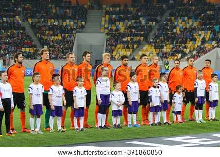 LVIV, UKRAINE - March 10, 2016: FC Shakhtar Donetsk players on the pitch before the UEFA Europa League Round of 16 game against RSC Anderlecht at Lviv Arena - stock photo